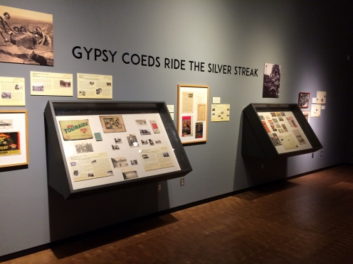 This portion of the exhibit tells of the 8 trips, listing the year, who went and displaying memorabilia from the trips.